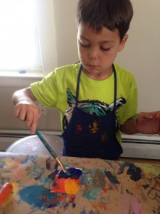 Young artist working on his impressionistic painting during our first Summer Art Camp of 2014!